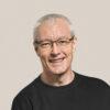 Cheerful senior man in a long sleeve black tee